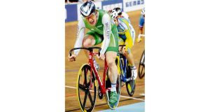 Ireland's Martyn Irvine crosses the line to win gold in the scratch race after securing silver in the pursuit an hour earlier at the UCI Track Cycling World Championships in Minsk yesterday.
