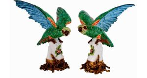 A pair of porcelain parrots