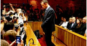 South African Paralympic athlete and murder-accused Oscar Pistorius stands at the dock before the start of proceedings at a Pretoria magistrates court. photograph: mike hutchings/reuters