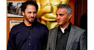 Guy Davidi and Emad Burnat, makers of Oscar-nominated 5 Broken Cameras, in Beverly Hills this week. photograph: reuters