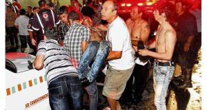 A victim of the fire in the Kiss nightclub in Santa Maria city is carried from the scene. photograph: deivid dutra/ap