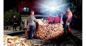 Wood is stacked during a Norwegian TV programme on the topic of firewood. photograph: lars mytting via the new york times