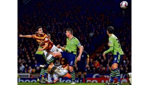 Bradford City's Irish defender Carl McHugh scores the third goal against Aston Villa during the League Cup clash at Valley Parade. photograph: paul ellis/afp