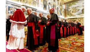 Meet and greet: Pope Benedict with cardinals and bishops in the Sala Clementina. photographs: claudio peri/afp/getty and franco origlia/getty