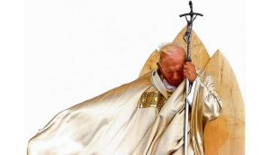 Good and bad?: John Paul II. photographs: ap and gabriel bouys/afp