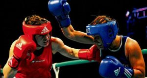 Katie Taylor (red) and Maike Kluners in their bout last night. photograph: aidan crawley