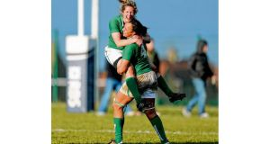 Ireland's Alison Miller and Sophie Spence celebrate at the final whistle after beating Scotland to claim the Triple Crown. Photograph: Dan Sheridan/Inpho