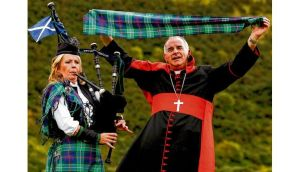 Cardinal Keith O'Brien posing in 2010 with the papal visit plaid in Edinburgh. photographs: dara mac donaill; reuters