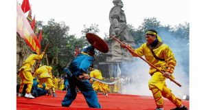 A battle between Vietnamese (yellow) and Chinese soldiers (blue) is re-enacted this month in Hanoi during the 224th Dong Da Festival. photograph: kham/reuters