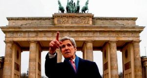 US secretary of state John Kerry in front of the Brandenburg Gate in Berlin yesterday as part of a nine- nation, 11-day trip that will also take him to Paris, Rome, Ankara, Cairo, Riyadh, Abu Dhabi and Doha. photograph: fabrizio bensch/reuters