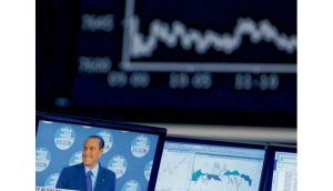 Silvio Berlusconi onscreen at Frankfurt stock exchange: the markets are alarmed at the poll outcome. photograph: lisi niesner