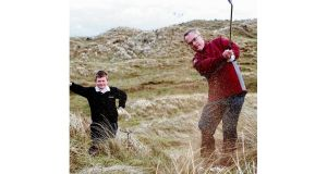 Alex Attwood plays golf on the site of the proposed development.