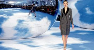 A Raf Simons design for Dior. photographs: benoit tessier, gonzalo fuentes/reuters