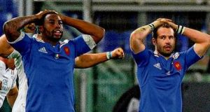 French players show their dejection following the defeat to Italy