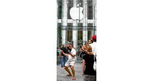 A customer outside New York's Apple Store in June 2007 after buying an iPhone Photograph: Don Emmert/Shaun Curry/AFP/Getty, Joe St Leger
