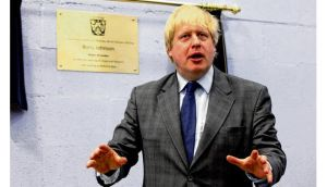 Mayor of London Boris Johnson unveils a plaque to mark the official opening of a youth club. Mr Johnson was strident in his defence of the City of London financial centre. photograph: yui mok/pa