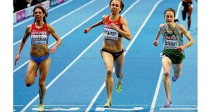 Ireland's Fionnuala Britton dips on the line to win the bronze medal in the 3,000 metres yesterday. photograph: pa wire