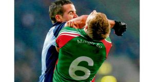 Dublin's Ger Brennan clashes with Mayo's Donal Vaughan at Croke Park on Saturday night. photograph: ryan byrne/inpho