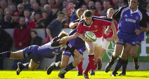 O'Gara playing for Munster breaks the Bath defence at Thomond Park in October 2000. Photograph: Dara Mac Dónaill/The Irish Times