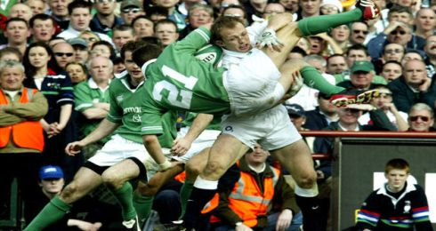 O'Gara is upended by England's Matt Dawson during the Grand Slam game at Landsdowne Road in March 2003. Photograph: Alan Betson/The Irish Times
