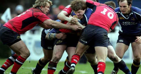Leinster captain Brian O'Driscoll takes on Munster trio Gary Connolly (left) John Kelly and O'Gara, in the Celtic League match at the RDS in December 2005. Photograph: Eric Luke/The Irish Times
