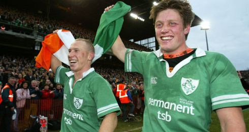 Peter Stringer and Ronan O'Gara celebrate Ireland's first Triple Crown since 1985 after the RBS Six Nations match between Ireland and Scotland on March 27th, 2004 at Lansdowne Road. Ireland. Ireland won the match 37-16. Photograph: Shaun Botterill/Getty Images