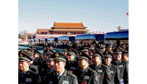 Chinese People's Liberation Army delegates march to attend a pre-opening session of the National People's Congress in Beijing yesterday. photograph: getty images