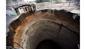 A giant sinkhole that swallowed several homes in Guatemala City  in 2007. Photograph: Daniel LeClair/Reuters