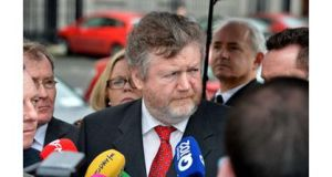 Minister for Health James Reilly has indicated that contractors working for his department's special delivery unit will face pay cuts. The department had last night said they would not.