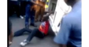 The South African police watchdog is investigating the death of a man who was apparently filmed being handcuffed to the back of a police van and dragged along the ground. Image: The Daily Sun/Screengrab.