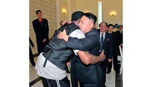North Korean leader Kim Jong-Un and former NBA basketball player Dennis Rodman hug in Pyongyang in this picture released by North Korea's KCNA news agency. Photograph: KCNA/Reuters.