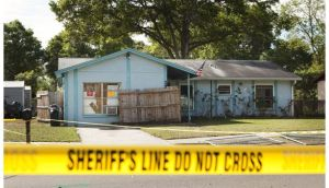 Police tape surrounds the house of Jeff Bush, who was consumed by a sinkhole while lying in his bed on Thursday night. Photograph: Edward Linsmier/Getty Images