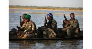 Malian soldiers head for the village of Kadji, which the army said was a stronghold of jihadists until Thursday. A jihadist magazine has warned France to end its military intervention there. Photograph: Joe Penney/Reuters