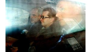 Gary O'Flynn (centre) is brought into Cork Court this morning. Photograph: Michael Mac Sweeney/Provision