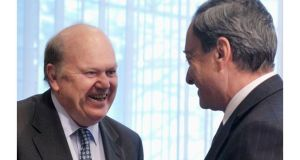 Minister for Finance Michael Noonan talks to ECB president Mario Draghi In Brussels today. The Department of Finance said today said its overall budget targets were being met in the first two months of the year.