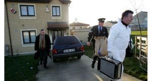 Gardai at the home of Evelyn Joel at Cluainn Dara, Enniscorthy  following her death in January, 2006. Photograph: Bryan O'Brien.