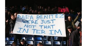 Chelsea fans display a banner as they protest against Rafael Benitez prior to the Premier League win over West Bromwich Albion at Stamford Bridge. Photograph: Scott Heavey/Getty Images