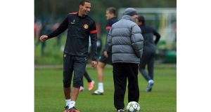 Manchester United manager Alex Ferguson jokes with Rio Ferdinand during a training session at Carrington. Photograph: Richard Heathcote/Getty Images