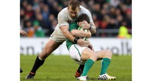 Ronan O'Gara of Ireland is wrapped up by Joe Marler of England during the Six Nations match between Ireland and England at Aviva Stadium. Photograph: David Rogers/Getty Images