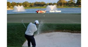 Michael Thompson plays his bunker shot on the 18th hole on the way to a two-shot victory at the Honda Classic in Palm Beach Gardens, Florida. Photograph: Stuart Franklin/Getty Images