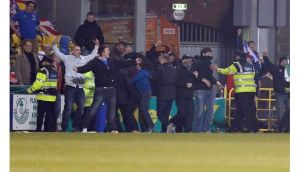 Linfield supporters encroach on to the pitch after Billy Joe Burns's goal for the visitors. Photograph: Donall Farmer/Inpho
