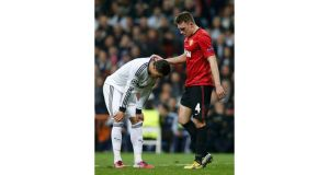 Real Madrid's Cristiano Ronaldo and Manchester United's Phil Jones during the 1-1 draw at the Bernabeu. Photograph: Susana Vera/Reuters