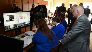 Minister for Education Ruairí Quinn with students from Warrenmount Presentation School, Dublin, as teacher Maria Broderick uses broadband to teach maths