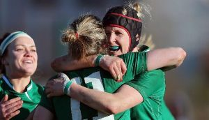 Ireland's Alison Miller celebrates her try against Scotland with Joy Neville. Photograph: Dan Sheridan/Inpho