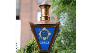 Gardai in Cork are this morning continuing to question a man arrested in connection with a raid on a city centre bank yesterday where a lone raider held up staff and made off with some cash.