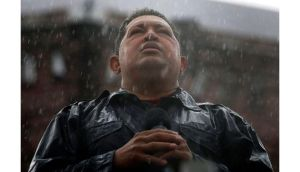 Venezuela's president and then presidential candidate Hugo Chavez speaks in the rain during his closing campaign rally in Caracas last October. Mr Chavez died last night after a two-year battle with cancer. Photograph/Jorge Silva/Reuters