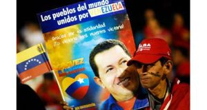A supporter of Venezuela's president Hugo Chavez holds a poster with a photograph of Chavez and the words