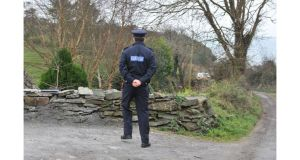 Garda near a farmhouse in Ballydehob, Co Cork from where a father and daugher were reported missing. The bodies of the man and three-year-old girl were taken from the sea off west Cork this morning. Photograph: Michael McSweeney/Provision