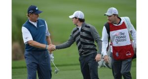 Rory McIlroy shakes hands with Ernie Els before walking off the course during the second round of the Honda Classic in Palm Beach Gardens, Florida. Photograph: Stuart Franklin/Getty Images