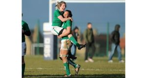Ireland's Alison Miller and Sophie Spence celebrate at the final whistle against Scotland. Photograph: Dan Sheridan/Inpho
